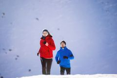Couple jogging in winter nature Royalty Free Stock Photo