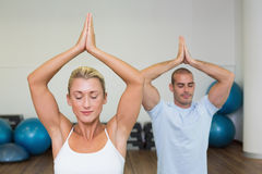 Couple with joined hands and eyes closed at fitness studio Royalty Free Stock Photos