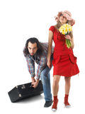 Couple at journey. A couple at journey, man pulling heavy luggage and careless woman standing near isolated on white Stock Photography