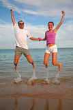 Couple jump Stock Photos