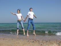 Couple jump. sea. Royalty Free Stock Image