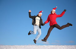 Couple jump on snow Stock Photos