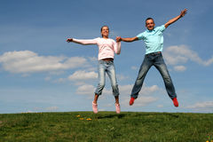 Couple jumping Stock Photography