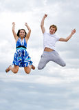 Couple jumping in the air Stock Image