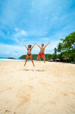 Couple jumping on a beach Stock Image