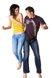 couple jumping excitedly Royalty Free Stock Photos