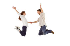 Couple jumping and holding hands Stock Photography