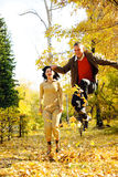Couple Jumping In Autumn Leafs Stock Images