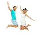 Couple jumping isolated on white Stock Photos