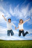 Couple jumping outdoors Stock Photography