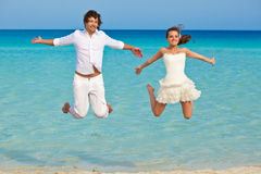 The couple is jumping in the sea Royalty Free Stock Photo