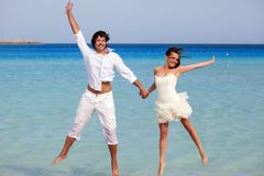 The couple is jumping in the sea Royalty Free Stock Image