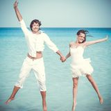 The couple is jumping in the sea Royalty Free Stock Images