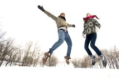 Couple jumping in snow. Young couple jumping in snow Royalty Free Stock Photos