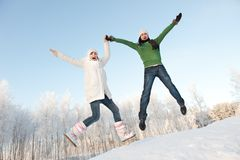 Couple jumping on a snowy background Stock Image