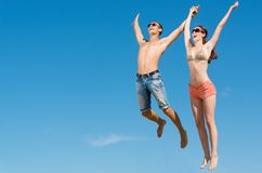 Couple jumping together Stock Image
