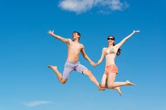 Couple jumping together Stock Photos