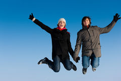 Couple jumping on a winter day Royalty Free Stock Photos
