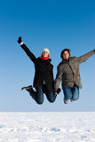 Couple jumping on a winter day Stock Photo