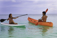 Couple with kayak and paddle board Stock Photo