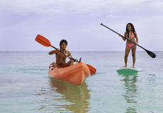 Couple with kayak and paddle board. Asian couple with kayak and paddle board in hawaii Stock Images