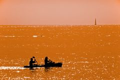 Couple kayaking at dusk Stock Image