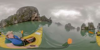 Couple kayaking in Ha Long Bay Vietnam stock images