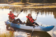 Couple kayaking on lake, front view, Big Bear, California Royalty Free Stock Image