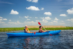 Couple kayaking on river Royalty Free Stock Image