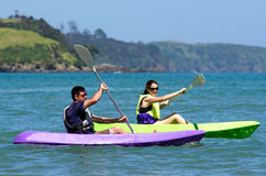 Couple kayaking at sea Stock Photo