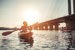 Couple kayaking on sunset Royalty Free Stock Photos