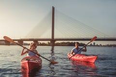 Couple kayaking on sunset Stock Photography