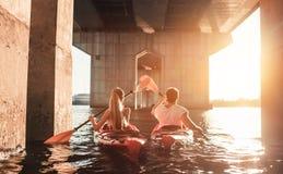 Couple kayaking on sunset Stock Image