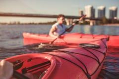Couple kayaking on sunset Royalty Free Stock Images