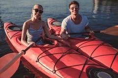 Couple kayaking on sunset Royalty Free Stock Photo