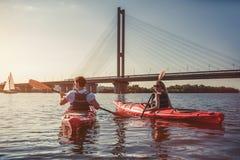 Couple kayaking on sunset Stock Photo
