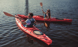 Couple kayaking on sunset Royalty Free Stock Photography