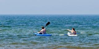 Couple in kayaks royalty free stock photo