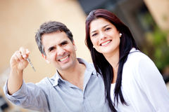 Couple with a key Royalty Free Stock Image