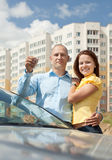 Couple with key against new house Stock Photos