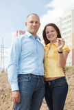 Couple with key against new house Stock Photo