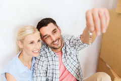 Couple with key and boxes moving to new home Stock Photography