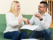 Couple with keys and documents Royalty Free Stock Photo