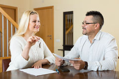 Couple with keys and documents Stock Images