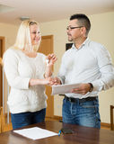 Couple with keys and documents Stock Image