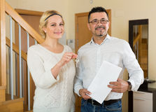 Couple with keys and documents Stock Photos