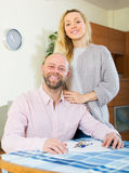 Couple with keys and documents Royalty Free Stock Photos
