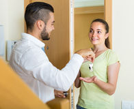 Couple with keys at the door Royalty Free Stock Photography
