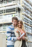Couple with keys on front of new modern house Stock Image