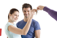 Couple with the keys of the new home Stock Photo
